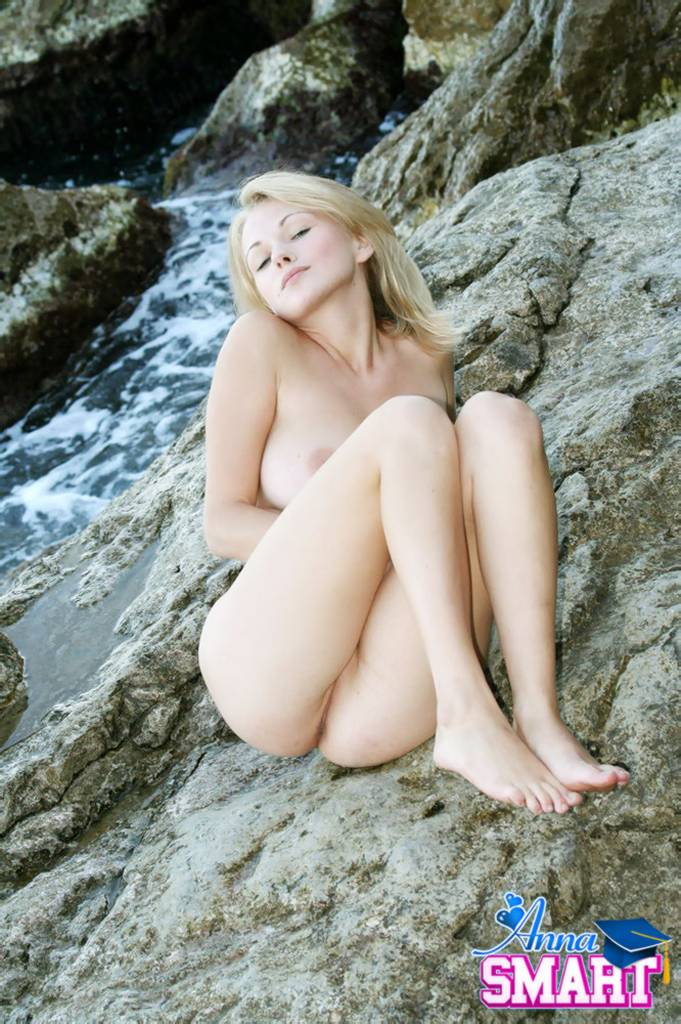 Blonde girl stripping on the beach - wildnudismcom