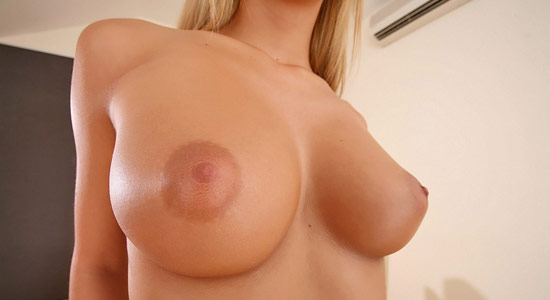 A beautiful close-up shot of Jessica Mazury's round tits